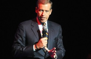 "FILE - In this Nov. 5, 2014 file photo, Brian Williams speaks at the 8th Annual Stand Up For Heroes, presented by New York Comedy Festival and The Bob Woodruff Foundation in New York. Williams says he's temporarily stepping away from his nightly newscast amid questions about his credibility. In a message sent to NBC News staff and released by NBC on Saturday, Feb. 7, 2015, Williams says it has ""become painfully apparent"" to him that his actions have made him too much a part of the news. (Photo by Brad Barket/Invision/AP, File)"
